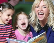 EMBARGOED UNTIL 0001 FRIDAY OCTOBER 5, 2012 Mother of two, Zoe Ball reads to Sophia Chapman aged 3 (left) and Indiana Ransley aged 4 (centre) at the launch of the Winnie the Pooh Storytelling Academy, an online resource for parents and grandparents, at Smithfield House Children's Nursery in London. PRESS ASSOCIATION Photo. Issue date: Friday, October 5, 2012. The Winnie the Pooh Storytelling Academy website http://www.disney.co.uk/winniethepooh/storytelling includes content around the importance of storytelling and tips and tricks to help parents, grandparents and carers at home, on the go and from afar. Photo credit should read: Matt Alexander/PA