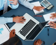 Accounting - Business people calculating budget in meeting
